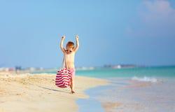 Happy stylish boy walking the beach royalty free stock photography