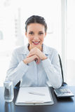 Happy stylish brunette businesswoman joining her hands and looking at camera Royalty Free Stock Photos