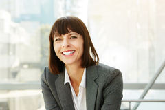 Happy stylish business woman in city Royalty Free Stock Photo