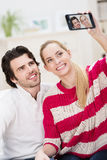 Happy stylish couple taking a self portrait Royalty Free Stock Photography