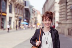 Happy Stylish Girl Walking at the City Street Stock Images