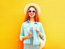 Happy stylish girll is using the smartphone in the city Royalty Free Stock Images