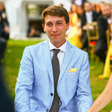 Happy stylish groom in blue suit smiling wedding ceremony Stock Image