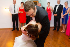 Happy stylish groom and bride are dancing on the background fash Royalty Free Stock Photos