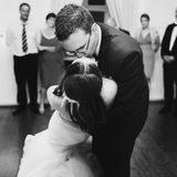 Happy stylish groom and bride are dancing on the background fash Royalty Free Stock Photography