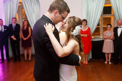 Happy stylish groom and bride are dancing on the background fash Stock Photos