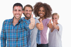 Happy stylish group giving thumbs up Royalty Free Stock Photo