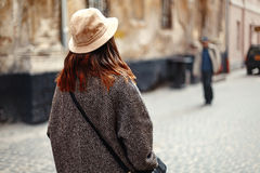 Happy and stylish pretty hipster woman walking on background of. Old streets in european city, travel concept Stock Photos