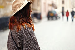 Happy and stylish pretty hipster woman walking on background of. Old streets in european city, travel concept Royalty Free Stock Photos