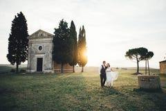 Happy stylish smiling couple walking and kissing in Tuscany, Ita Royalty Free Stock Image
