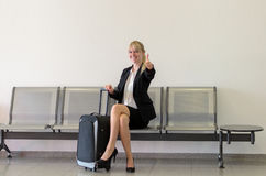 Happy stylish woman waiting for a flight or train Stock Images
