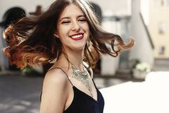 Free Happy Stylish Woman Waving Hair In Sunlight At Old European City Royalty Free Stock Photography - 121977267