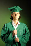 Happy succesful man on his graduation day in green Stock Photos