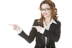 Happy success business woman pointing Stock Photography