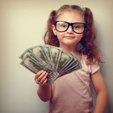 Happy success kid girl in eye glasses holding in hand american d Royalty Free Stock Photo