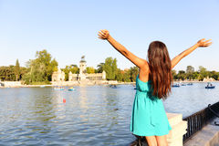 Happy success woman in Madrid park El Retiro Stock Photos