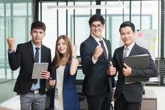 Happy successful Asian business team Stock Photo