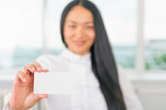 Happy and successful asian businesswoman gives you a business card Royalty Free Stock Photo