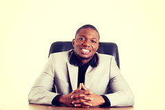Happy successful businesman at the desk. Royalty Free Stock Photos