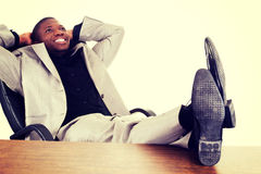 Happy successful businesman at the desk. Stock Images
