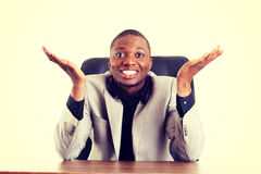 Happy successful businesman at the desk. Stock Image