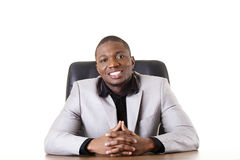 Happy successful businesman at the desk. Royalty Free Stock Photo