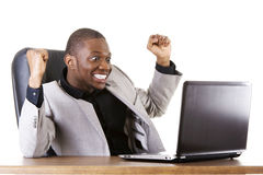Happy successful businesman at the desk. Royalty Free Stock Images