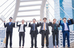 Happy Successful business group People Hands Raised successful with city background Successful business group with arms up. With city background royalty free stock photos