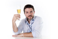 Happy successful business man drinking Champagne on white background Royalty Free Stock Photos