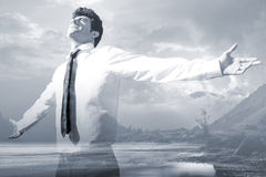 Happy successful business man raised arms with sky in the backgr. Outdoor portrait of happy successful business man raised arms with sky in the background Royalty Free Stock Photos