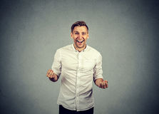 Happy successful business man winning fists pumped celebrating success Royalty Free Stock Photo