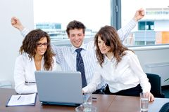 Happy successful business team. Happy successful business people sitting on meeting at office, working on laptop computer, smiling stock image