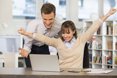 Happy Successful  business team in office, with arms up Stock Images