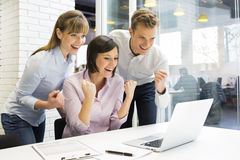 Happy Successful  business team in office, with arms up Royalty Free Stock Images