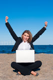 Happy successful business woman on the beach, vert Stock Image