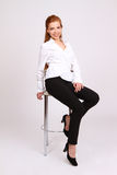 Happy successful business woman in  chair on white background Royalty Free Stock Images
