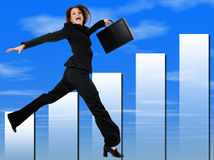 Happy Successful Business Woman Jumping and Smiling. Blue cloud graph background stock photography
