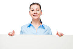 Happy successful business woman lady holding a big poster. In front of a white background Royalty Free Stock Photography