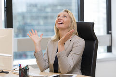 Happy successful business woman in office. Building background Stock Images