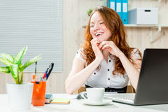 Happy successful business woman in office Stock Photo