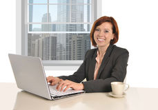 Happy successful business woman working at office computer Stock Photo