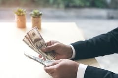 Happy and successful businessman holding US dollar money bills i royalty free stock photography