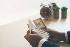 Happy and successful businessman holding US dollar money bills i royalty free stock image