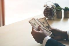 Happy and successful businessman holding US dollar money bills i stock image