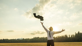 Happy Successful Businessman Throwing His Coat In The Air Stock Images