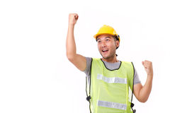 Happy, successful construction worker looking up stock images