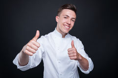Happy successful cook indicate double like sign stock photo