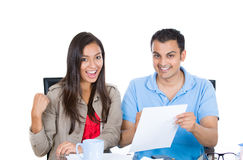 Happy, successful couple planning for future financial success Royalty Free Stock Photography