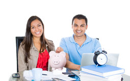 Happy, successful couple planning for future financial success Royalty Free Stock Photos