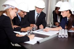 Happy successful engineers brainstorming Royalty Free Stock Photos
